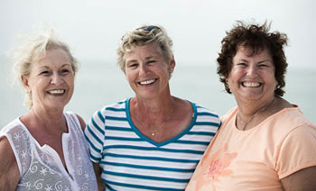 3 older ladies smiling